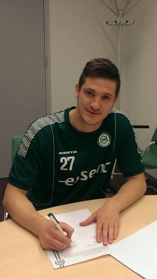 Denkovski signing his deal; photo: His Facebook