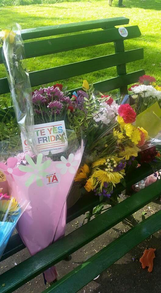 The bench where Declan Flynn sat before being murdered. People coming and leaving their badges. What a day. http://t.co/cFTNhqefqm