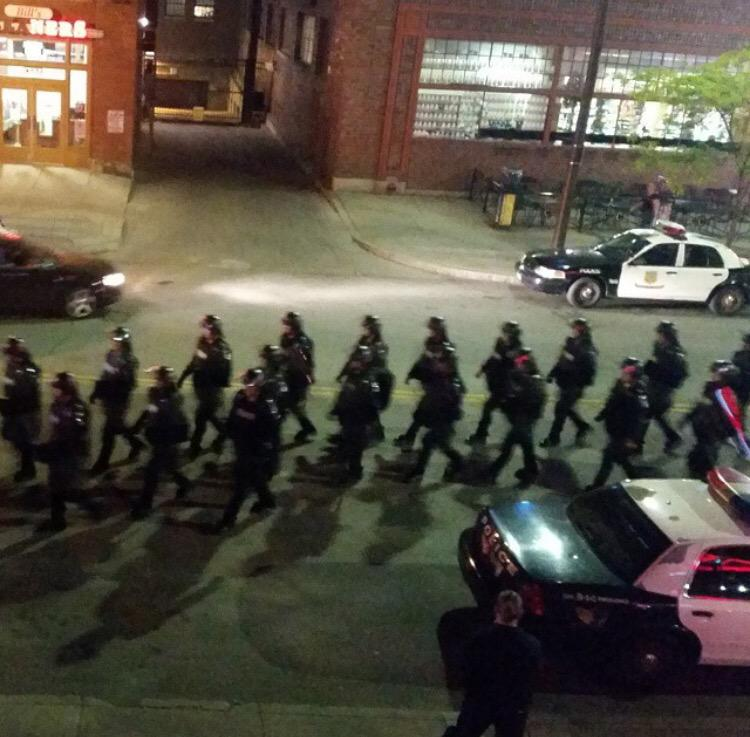It's #MemorialDayWeekend the police are outside in riot gear w/ NO RIOTERS around. #BreloVerdict #PrayForCleveland http://t.co/Bl7pbllEy7