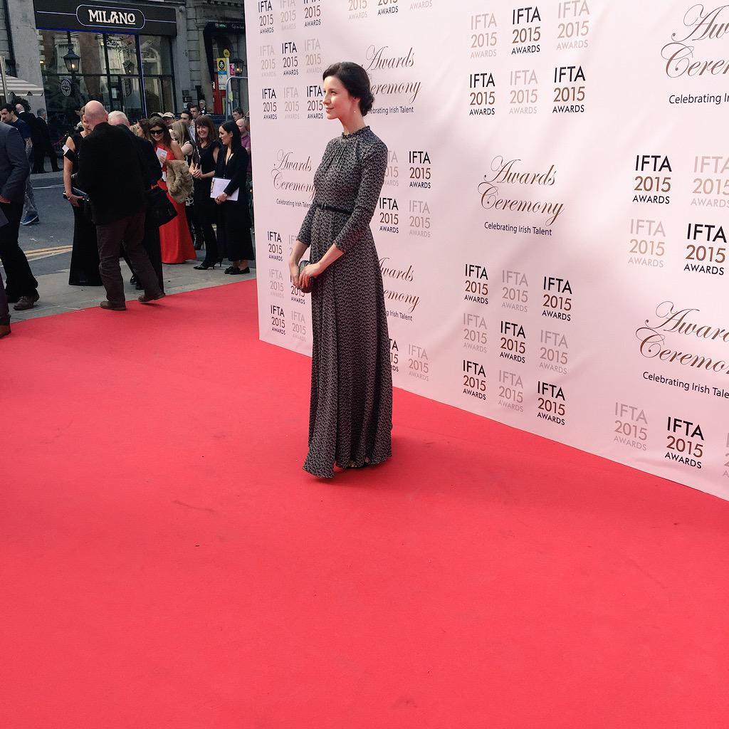 Caitriona Balfe wearing Irish designer Orla Kiely on the red carpet.