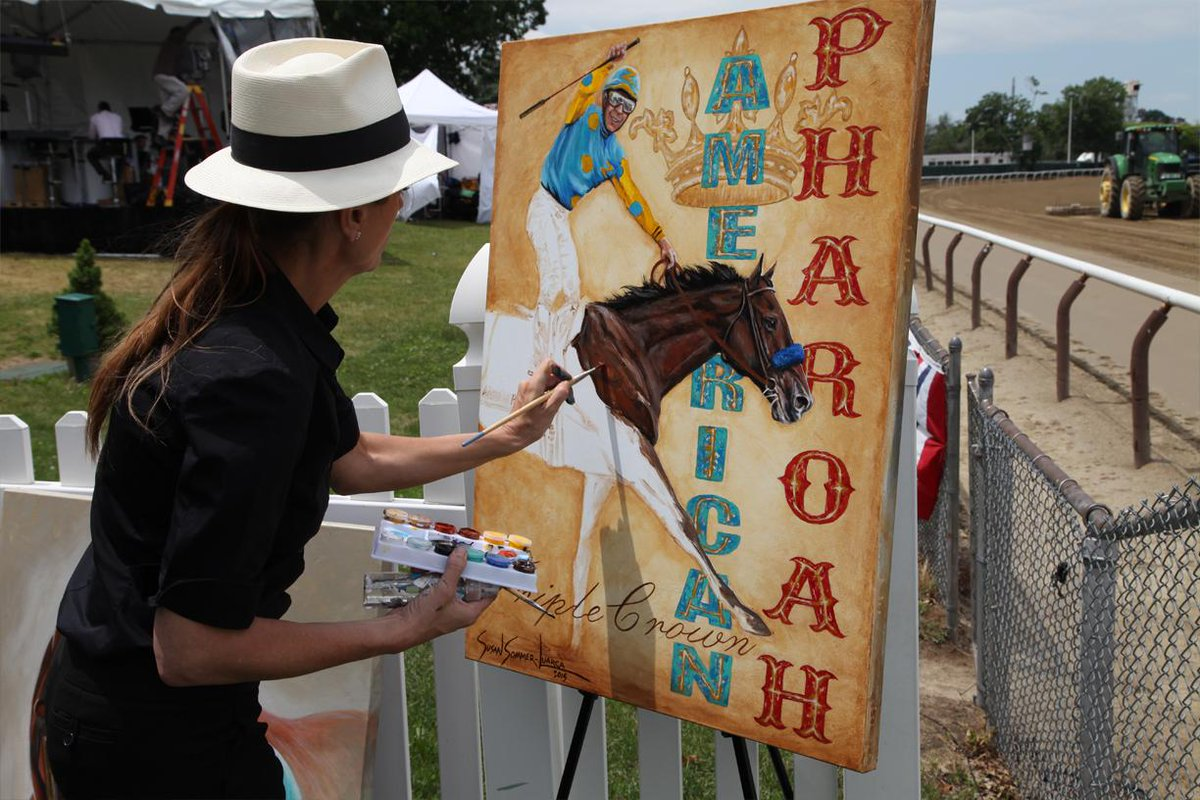 Susan Sommer-Luarca is painting some AMAZING @amer_pharoah pieces of art right next to the track! #TripleCrown
