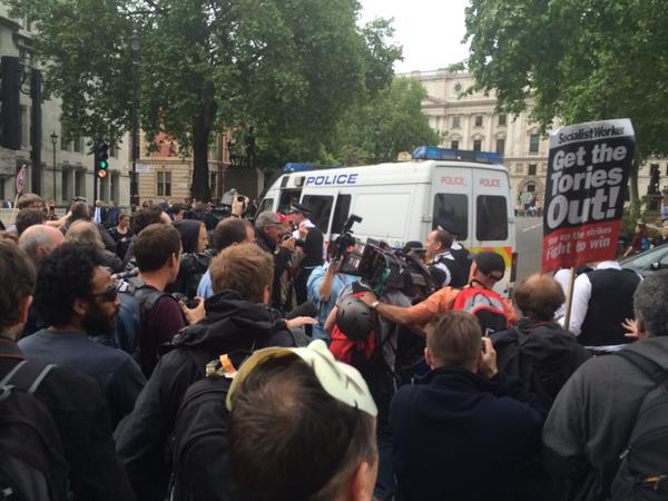 R @RTUKnews UPDATE:The police and protester scuffles are getting 'more violent': http://t.co/3QRscCtZ9l #QueensSpeech http://t.co/d0IO6PfW9m