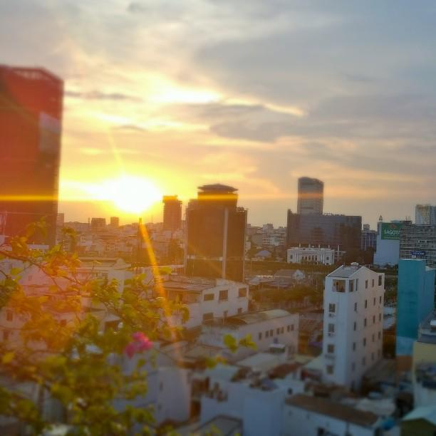 #sunset in #hcmc. This is truly the #hidden #beauty of #saigon. Photo by: Rui http://t.co/6bfljURf7w http://t.co/cgWqNjxdU2