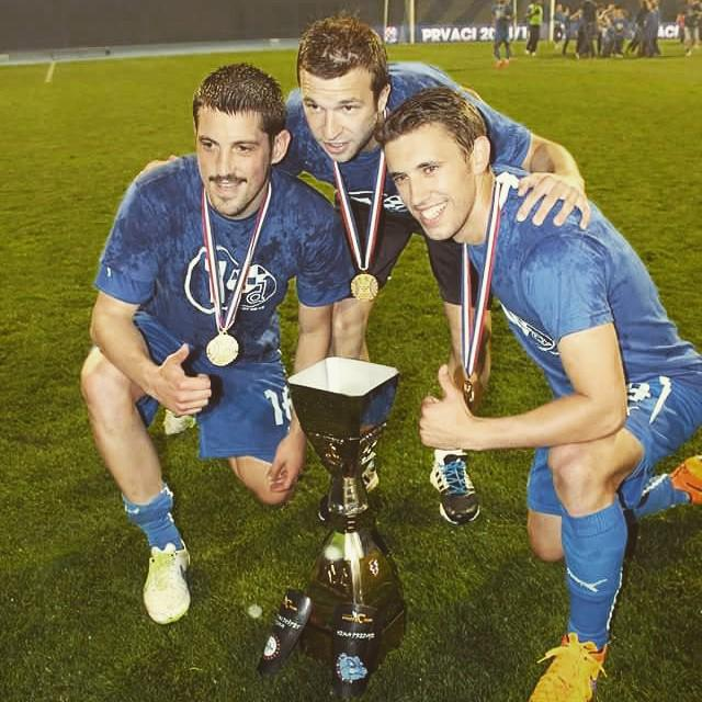 Ademi and teammates with the league trophy