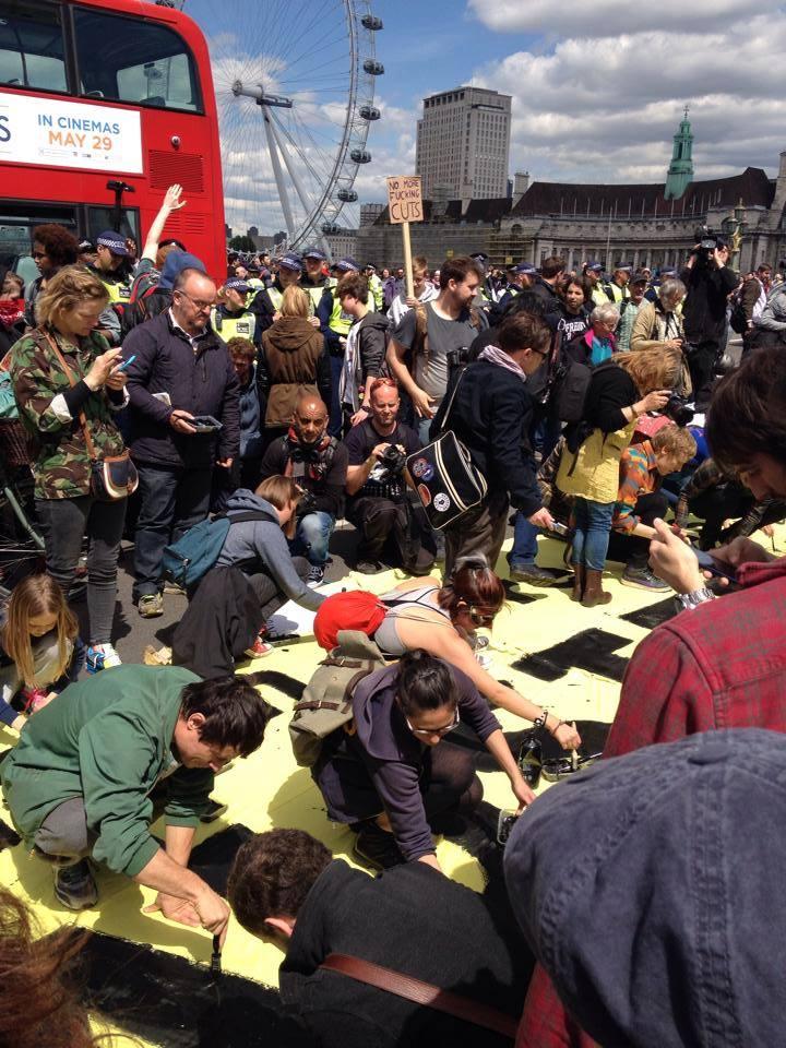 Activists blocking Westminster Bridge right now @UKuncut @pplsassembly @SistersUncut http://t.co/oNyq19L3XO