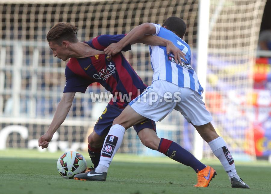 Babunski battles for the ball
