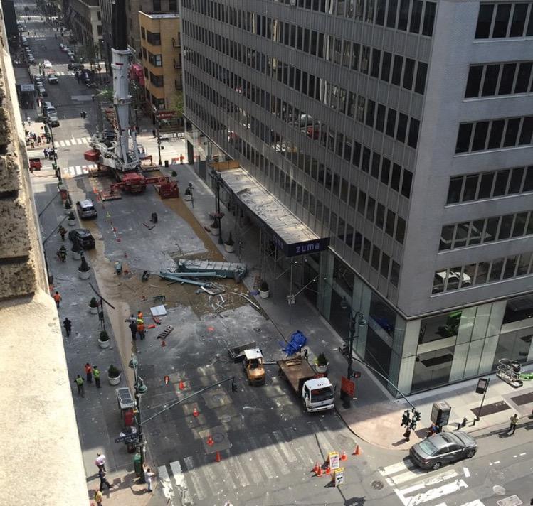 Ten people injured as debris falls from crane in New York City