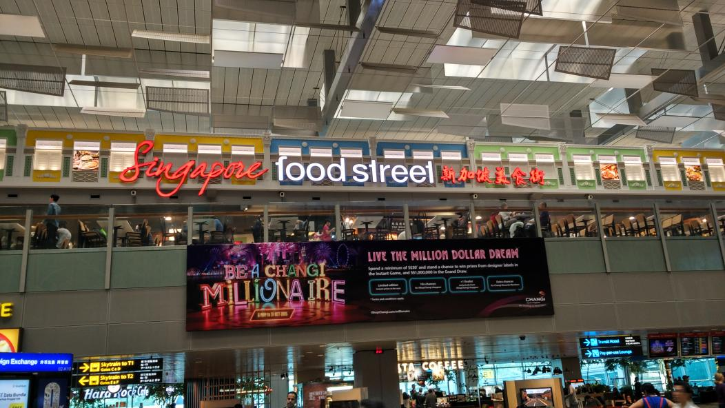 Singapore food street outlet at #Changi airport has a cool design, complete with foodcarts n zebra crossing on floor http://t.co/X6Hjze8QtQ