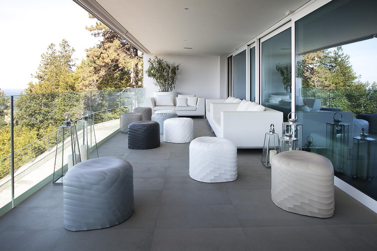 We are loving the River Stone stool! Very modern sculptural design - http://t.co/wU1egFLy49 #furniture #macstoppa