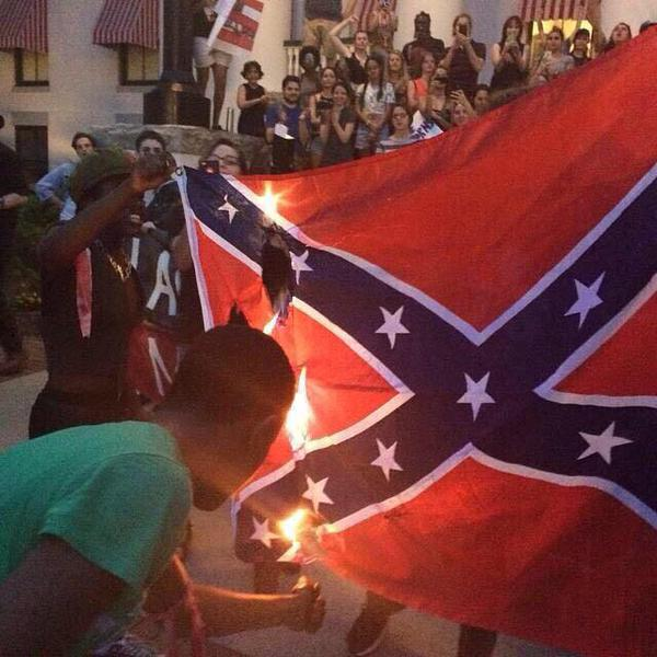 They burned Confederate flags last night in several cities. This is Seattle. #uppers http://t.co/LoJHUeqlv7