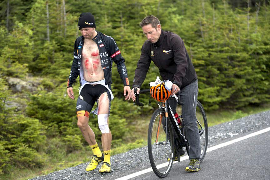 Bike racing can be a cruel sport. @rusty_woods at the @TourDeBeauce. Lots of road rash but he's doing OK. http://t.co/2JLFuHlWOf