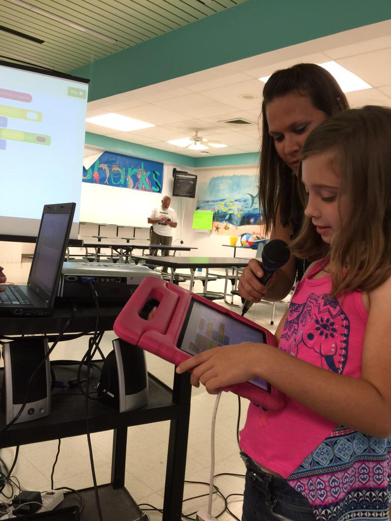 Madeline showing how she uses @hopscotch  to a room full of teachers at #edcampvolusia http://t.co/tfOxNFxdoI