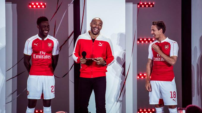 On Monday evening Puma unveiled Arsenal s brand new home kit for the 15 16  season outside the Emirates stadium. 24928fa39