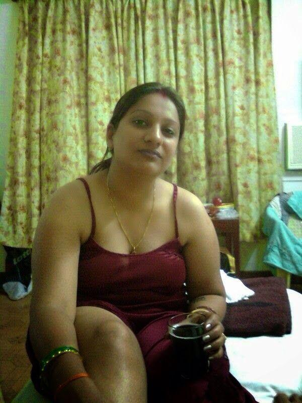 Indian hot sexy boobed aunt giving a teasing hot show on webcam during chat session
