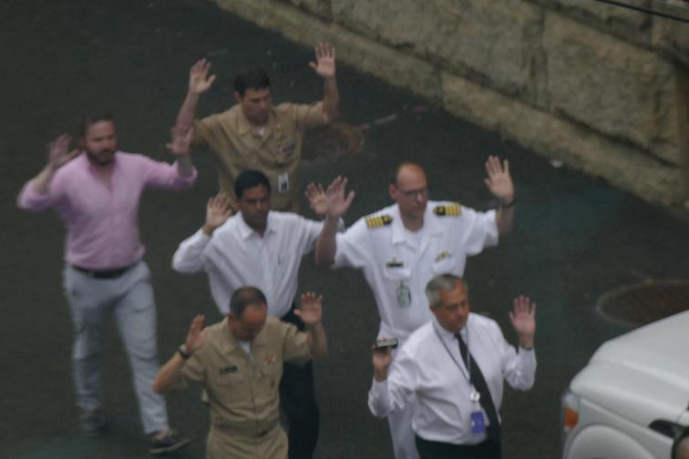 CNN iReporter Michael McDonald snapped this image of people running out of Navy Yard with their hands in the air http://t.co/c1waSREHBj