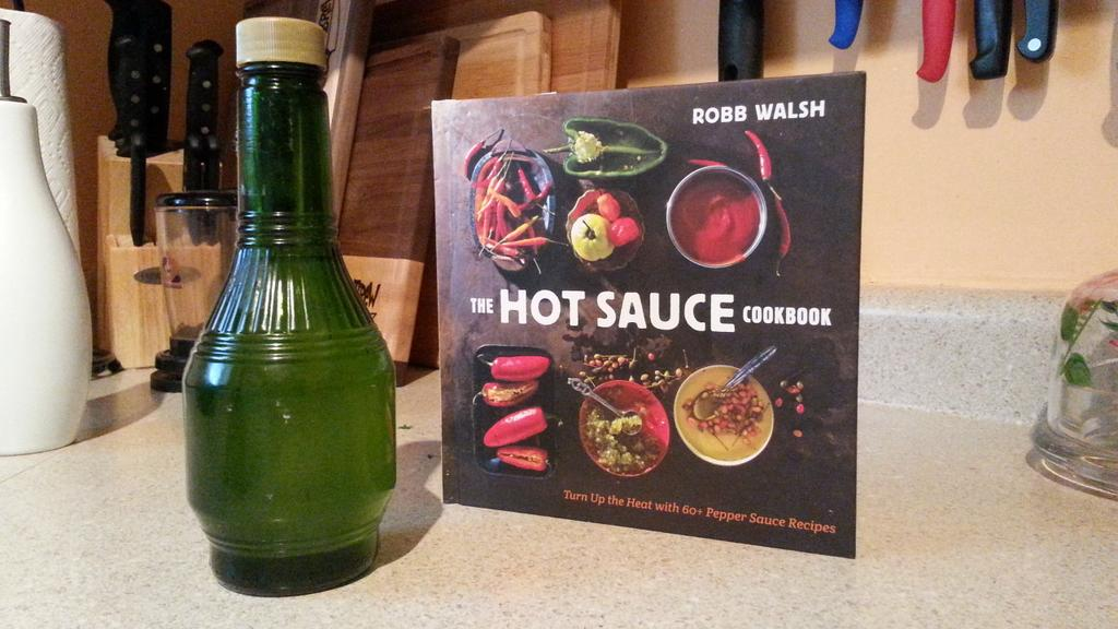 New obsession: homemade pepper vinegar w/ habanero, onion, carrot  @robbwalsh #HotSauceCookbook Great on everything! http://t.co/liMal44t68