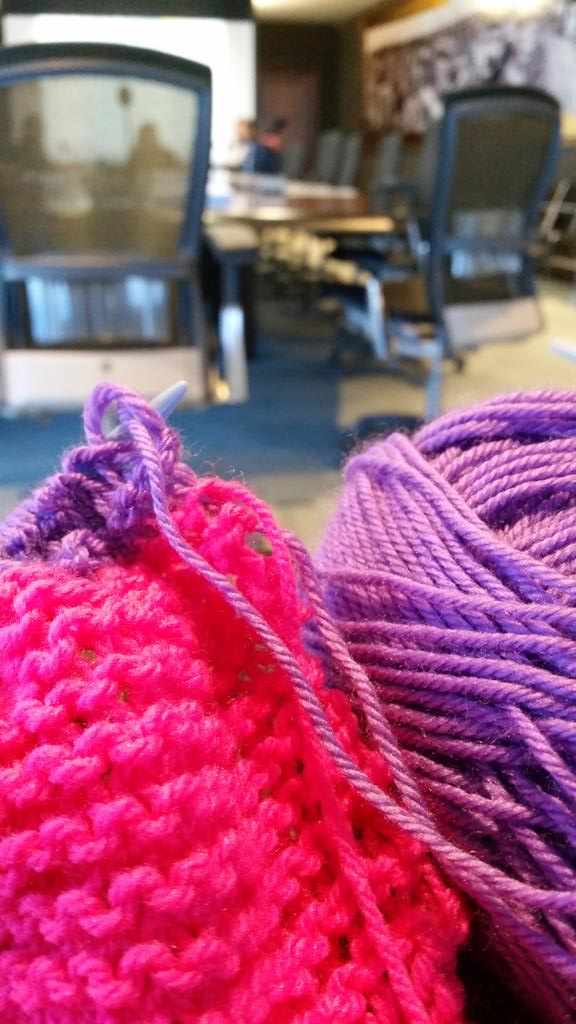 Day 3 learning to knit woth @SewLoveTeaDo now added purple... slightly wonky #whatwarmsmywinter while in a meeting http://t.co/PVzB0Oszir