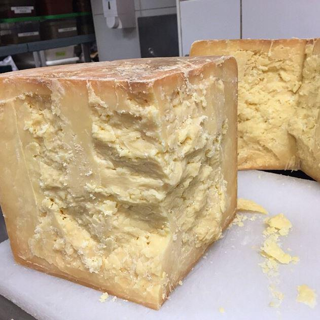 27 month aged cheddar from #pyengana in north-east #tasmania. Just cut from a 17kg wheel at #rockpoolbarandgrill #syd http://t.co/rSg59ywLQ8