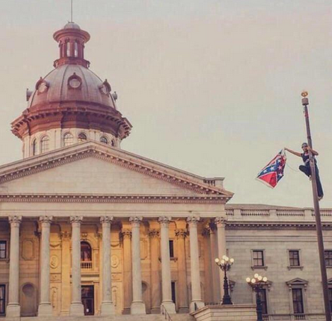 .@BreeNewsome taking down the Confederate flag over the #SC state grounds today is pretty amazing #FreeBree http://t.co/zcY7fhNMX6