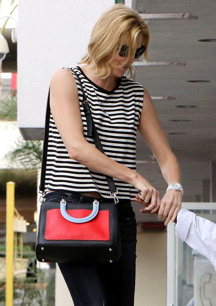The Many Bags of Charlize Theron http://t.co/4jvejlif0X http://t.co/aGW0mi4DKv