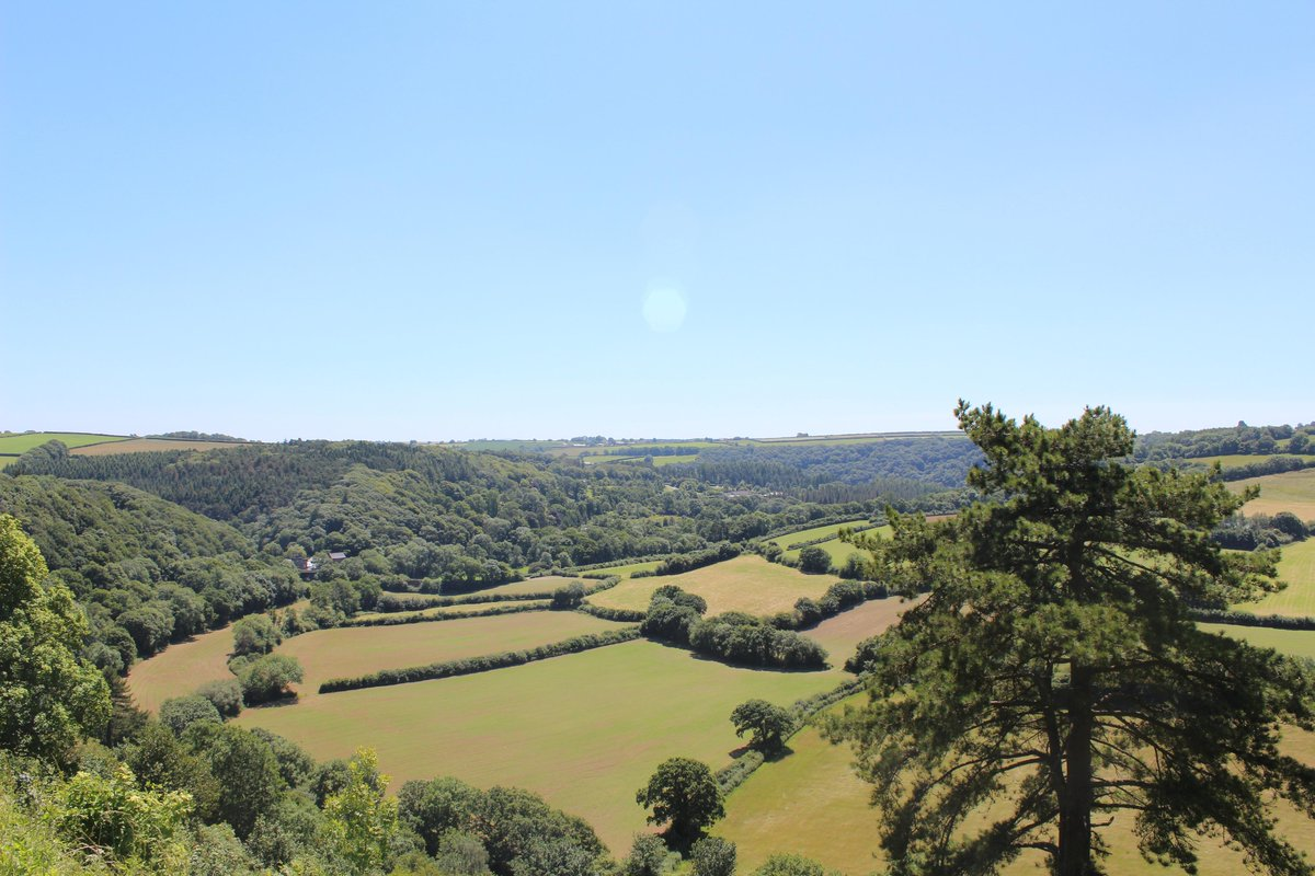 Baking hot in @torringtondevon.  Stunning view across the valley to @RHS_Rosemoor. @lovenorthdevon