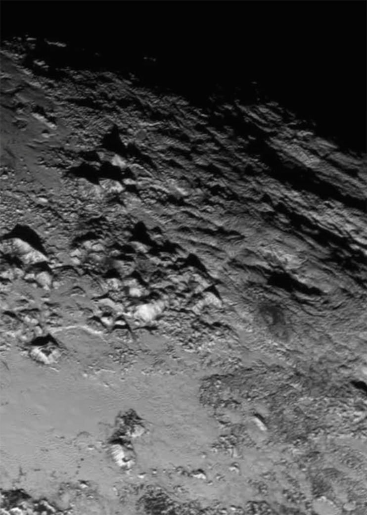 A different perspective of the just release zoomed image of one area on Pluto. Wow. Look closer. #PlutoFlyBy http://t.co/RJBiUFetYF