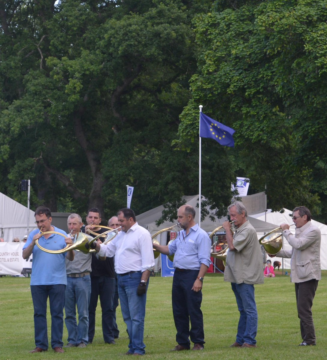 A group of French horn-blowers at the Scottish Game Fair today.   @ScotGameFair @SconePalace http://t.co/xFaNfdrnL4