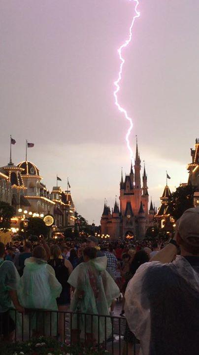 Lightning strikes over cinderella castle at walt disney ...