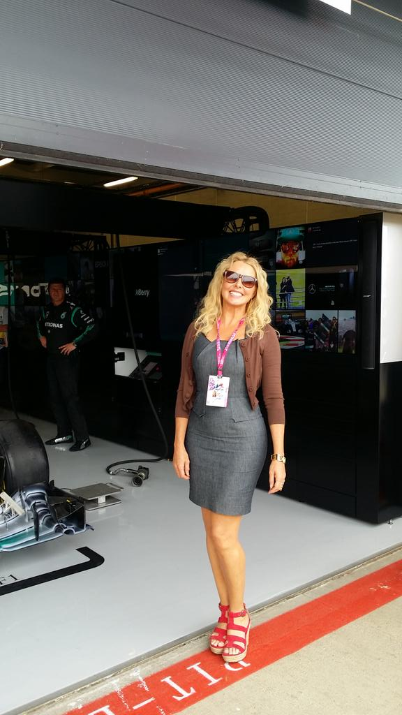 Hanging around  the @MercedesAMGF1 garage.... No overalls this time x http://t.co/m3CKeIl4CT