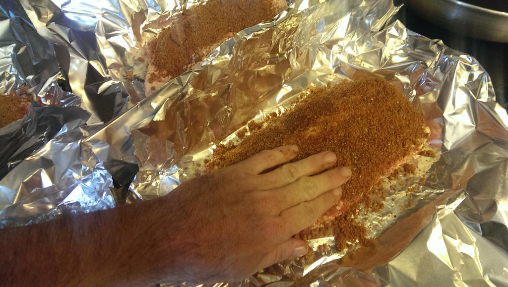 Spread and press the rub into the meatiest, just so it sticks. You gotta wash your hands a lot. #xtophoodnetwork http://t.co/TfWhO8dt0r