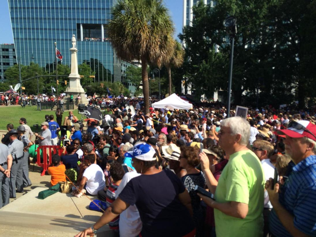 there are thousands here, and it's sweltering heat. SC battle flag coming down. http://t.co/eMRvcaqxAw