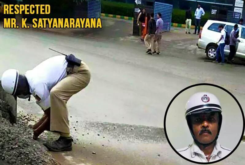 In Bangalore, This conscientious cop who cleared the road Single handedly for smooth traffic. Lets make him famous.. http://t.co/taNjWNthaQ