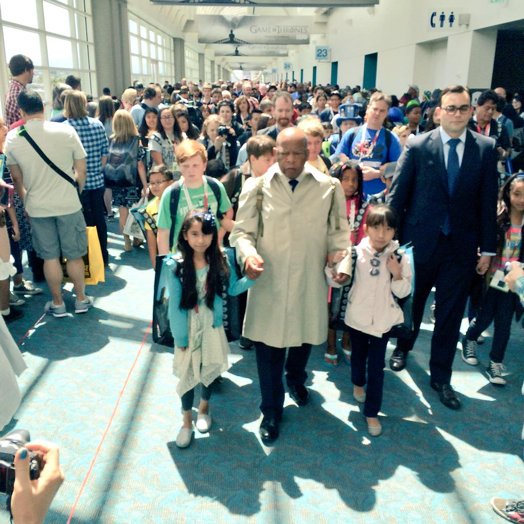 .@repjohnlewis leads a Children's March from his panel down to his book signing in #SDCC booth 1721 http://t.co/5Y2Od90Cyu