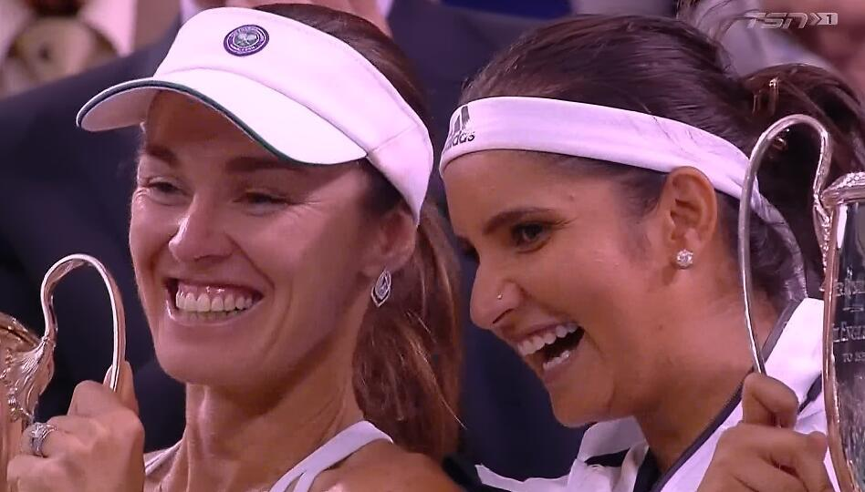 That's how happy they are! Congratulations to Martina Hingis and Sania Mirza! #Wimbledon #Champions http://t.co/j9pEMWey0l
