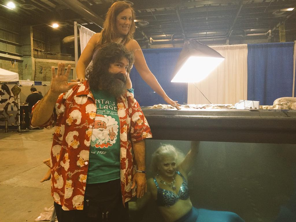 Oh look! @RealMickFoley is frolicking with the mermaids of @Shark_Con http://t.co/bZIScpVd7J