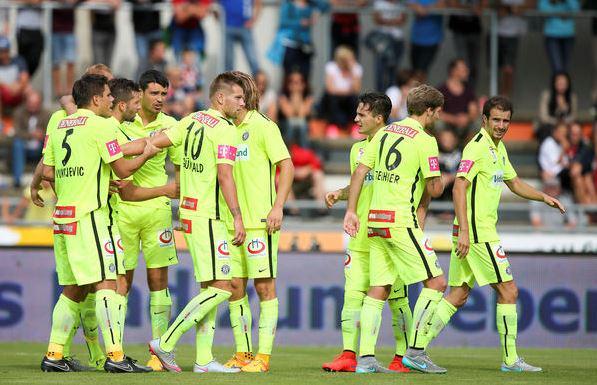 Shikov and his teammates celebrate a goal