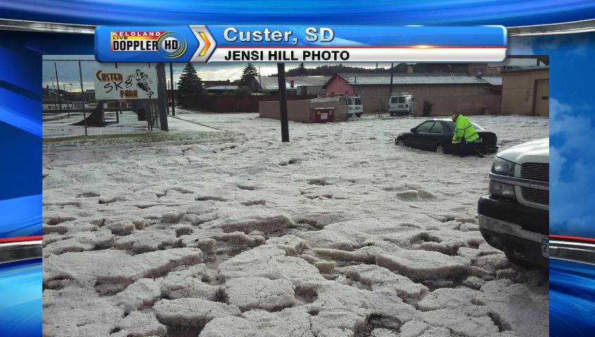 Tonight: Car stranded in pile of hail on 8th street in Custer, SD. #kelowx http://t.co/JRMEcc14mh