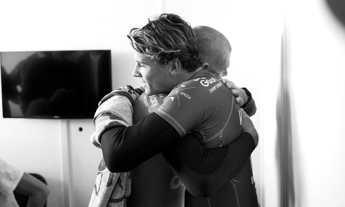 Friends first. @Mick_Fanning & @julian_wilson share a moment of relief safely on the beach #JBayOpen 📷@kirstinscholtz http://t.co/pNU6NX1M6t