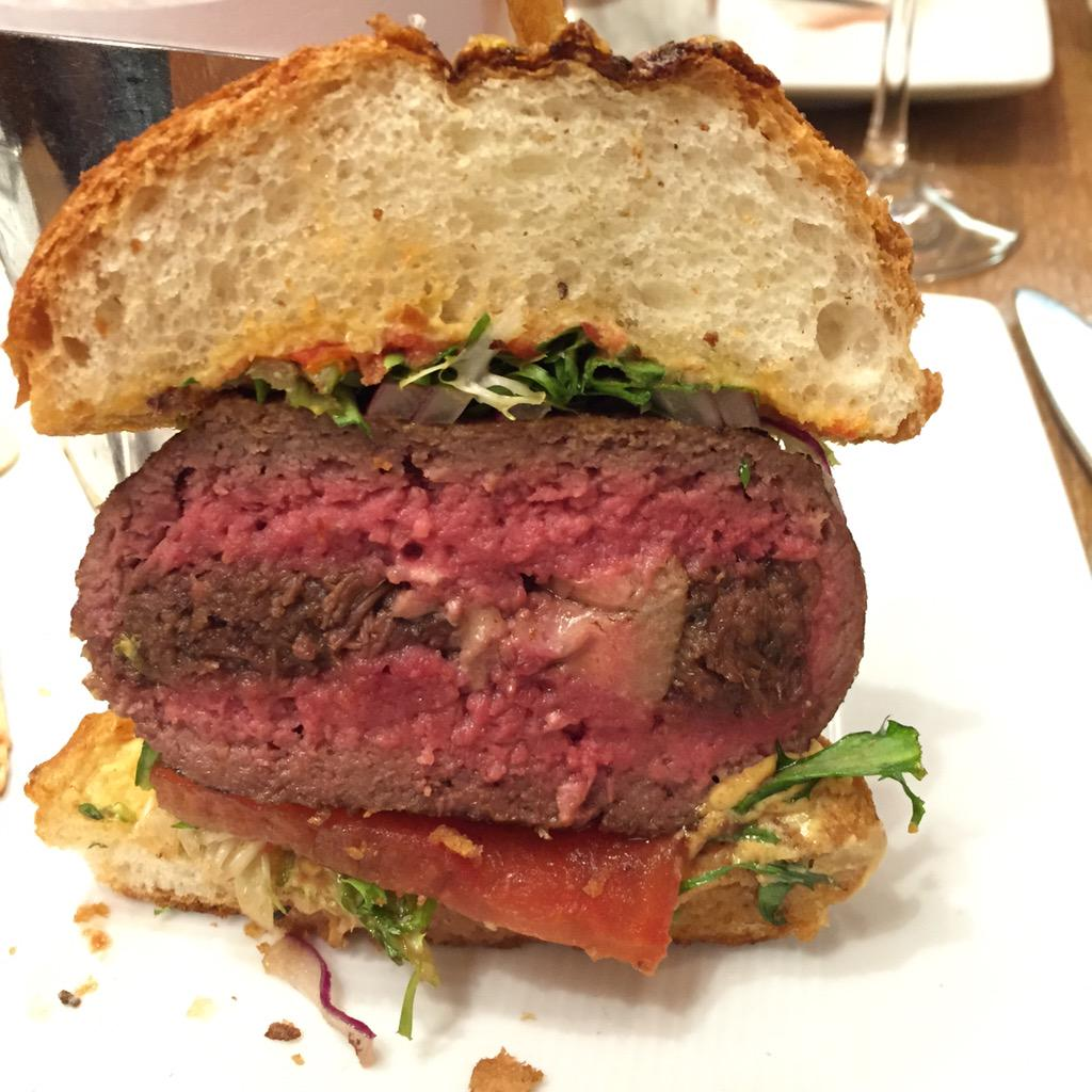 Lunch at @dbBistroNY - the famous #burger stuffed w/ braised short ribs, truffle and foie gras http://t.co/f8fAO1s5AR