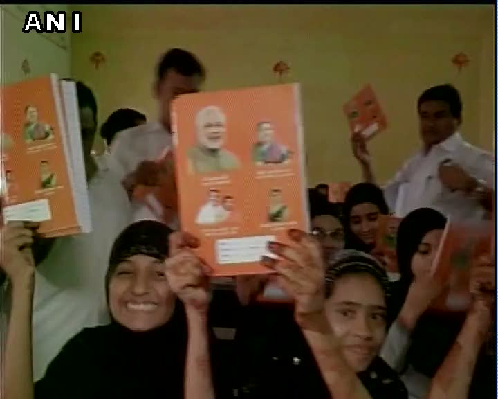 BJP MP CR Patil distributes notebooks with PM Modi and CM Anandiben Patel's pictures on it in schools of Surat