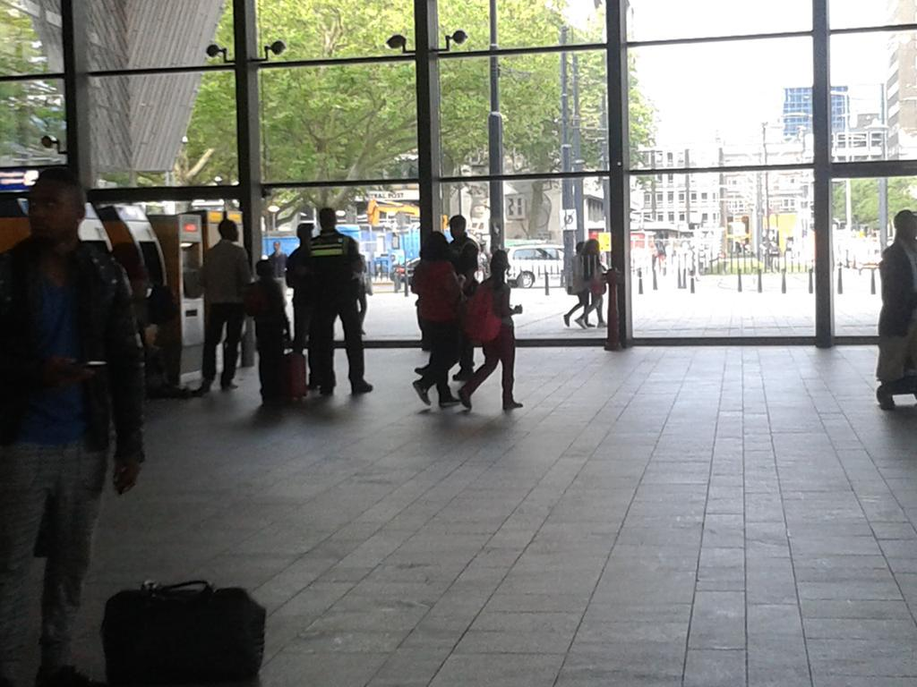 Standing on Rotterdam Central station for 20 minutes watching police picking out men of color to stop-and-frisk. http://t.co/ORqJhn6VGP