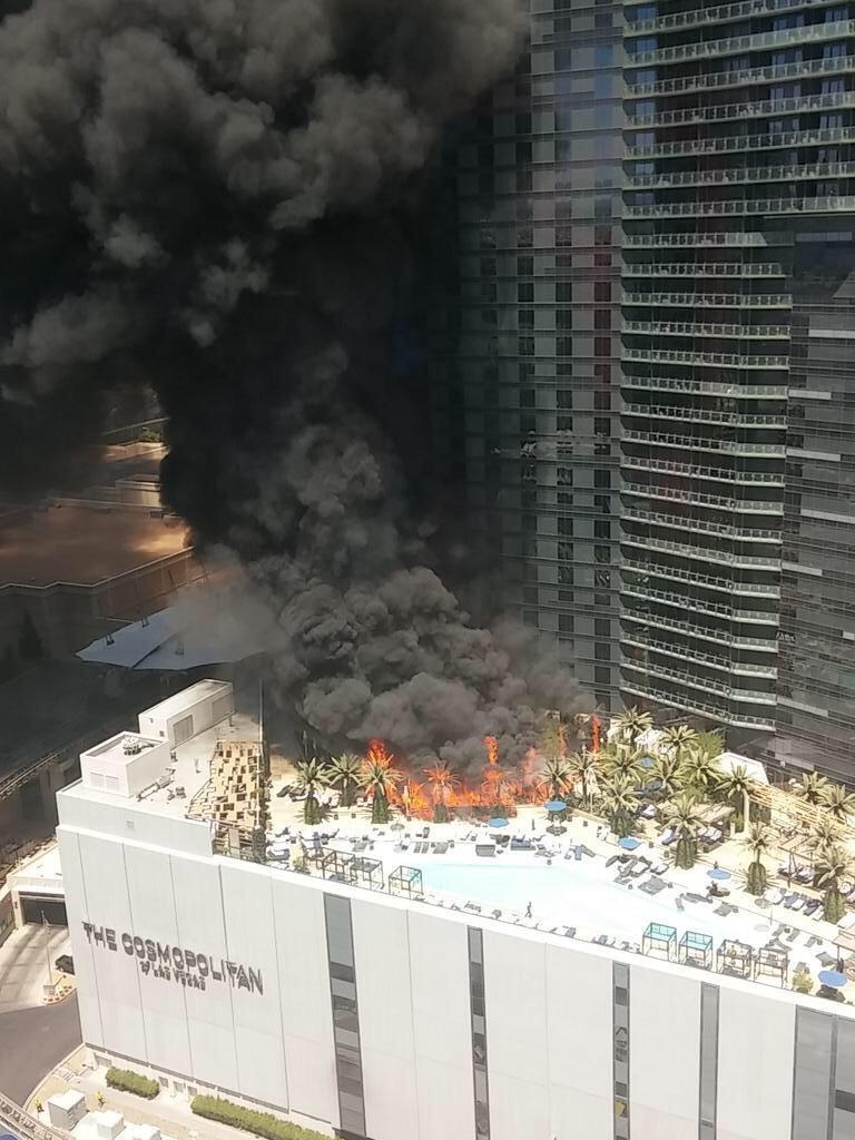 Another angle of fire at The Cosmopolitan. Fire chief confirms 14th floor of hotel is on fire and there are injuries http://t.co/LxRpktCEcQ