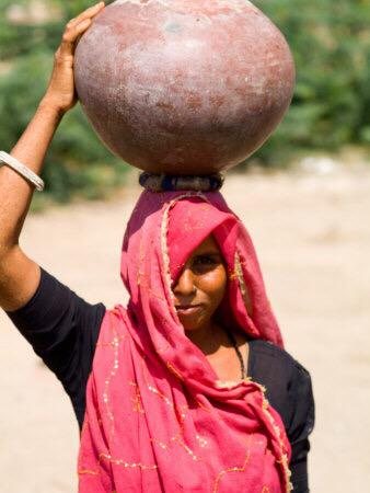 @eeekster women carry 50lbs of water on their heads - on a woven pad of grasses. http://t.co/tEclqBhPZX