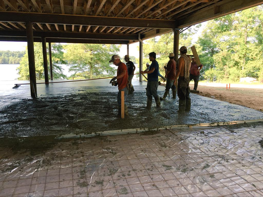 Pouring concrete beneath dining hall. #honeybrake #summercamp #construction