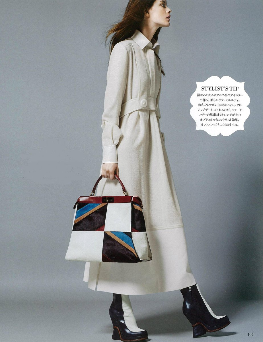 9c0a330bb74 a fendi fw15 look paired with a patchwork peekaboo bag in harpersbazaarjp