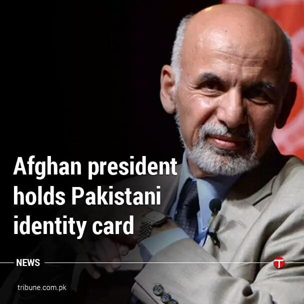 Caption This   Afghan president holds Pakistani identity