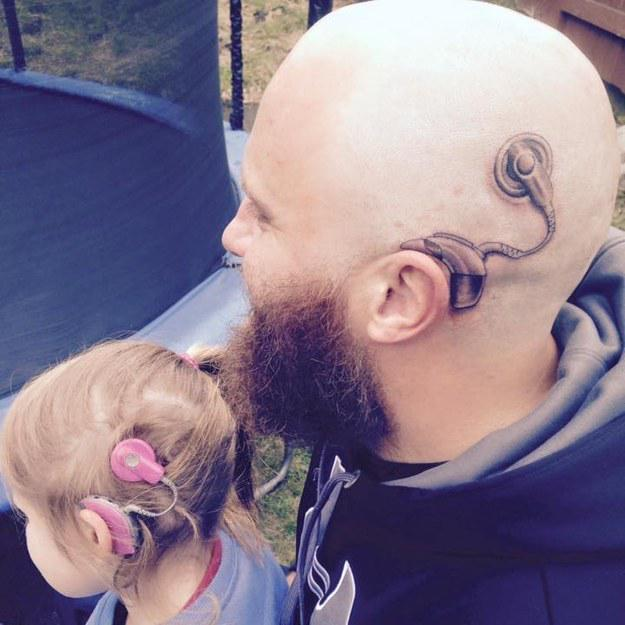 This Dad Got A Tattoo Of A Cochlear Implant To Match His Daughter's And It's The Sweetest http://t.co/ayXTxm22no
