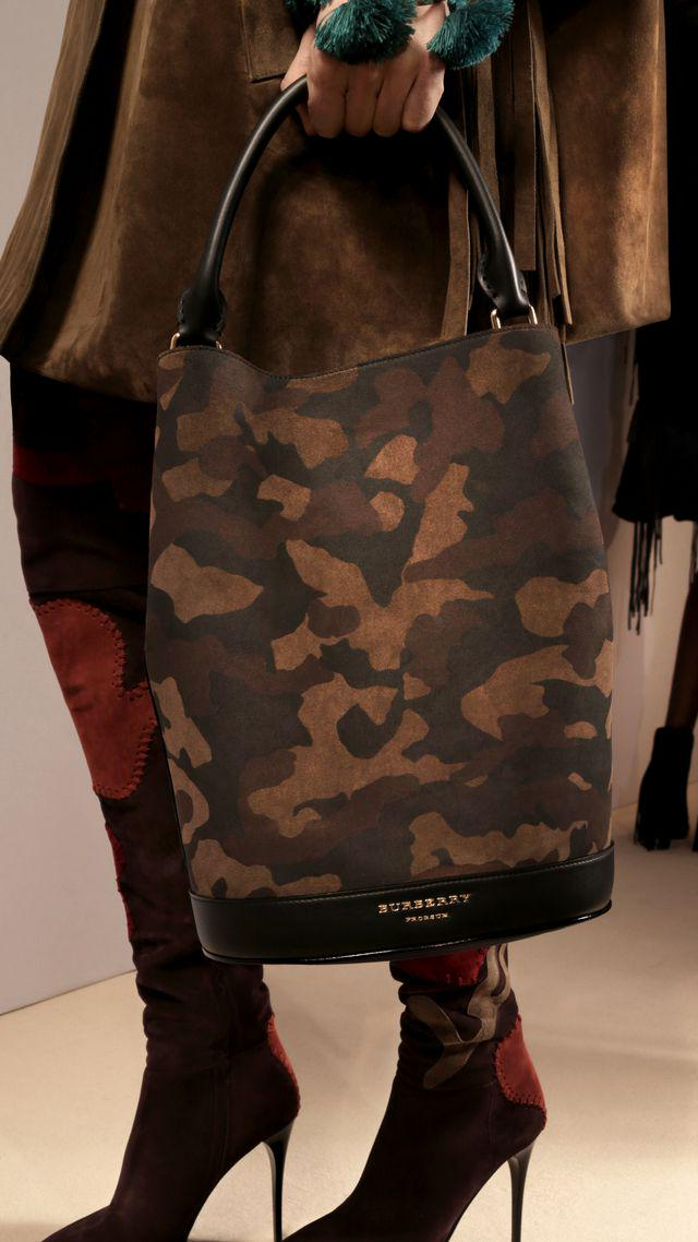 4204f9d061ed explore the bucket bag collection from burberry featuring runway inspired  camouflage print
