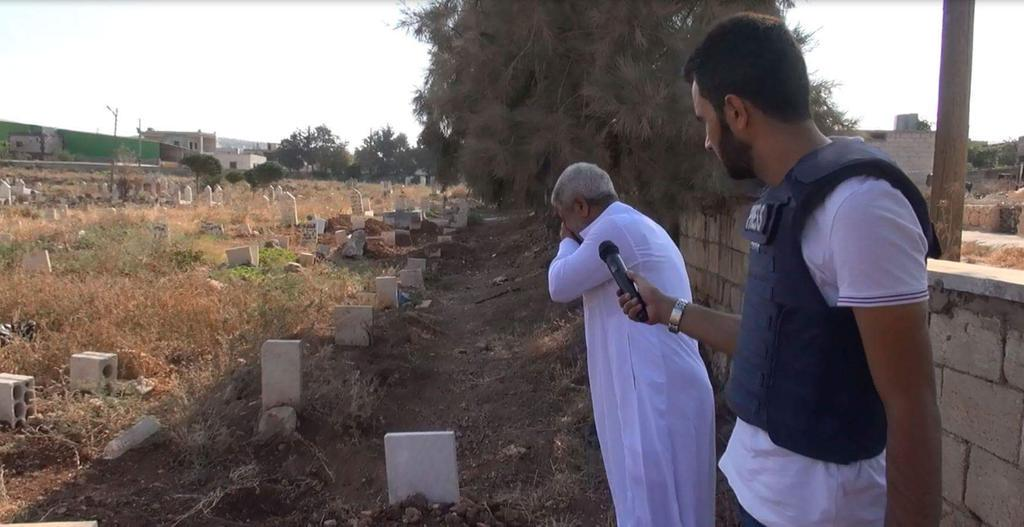 This grandfather cries at the graves of his five grandchildren killed by United-States led international coalition air strikes on Atmeh, Syria