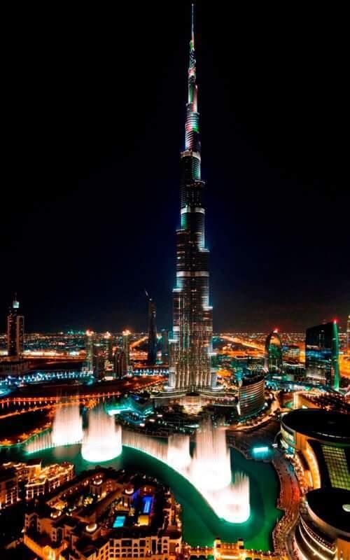 Burj Khalifa draped in Indian tri colour flag colours ahead of PM Modi's trip to UAE. http://t.co/gEzi8CH1Wf